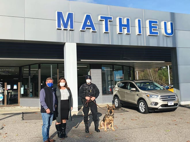 Mathieu Ford recently donated $500 to support Clyde, the Winchendon K9, in his continuing health recovery. The police dog was diagnosed with lymphoma about a year ago. Tighe Mathieu and Meg Mathieu Stone of Mathieu Ford are shown with Officer Jim Wironen and Clyde.