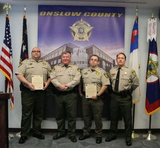 Major L. Straughn recently assumed the role of Major for the Onslow County Detention Center and Capt. P. Greene assumes the role as Captain. Both men were promoted and pinned Nov. 2. They are pictured with Sheriff Hans Miller and Col. Chris Thomas.