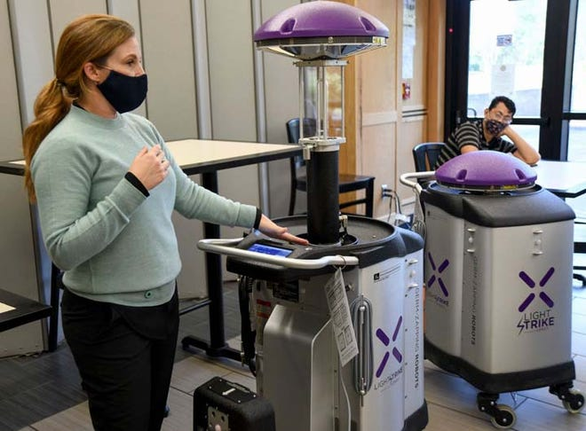 Robotic machines are the newest additions to the Naval Hospital that uses ultraviolet light to destroy pathogens that can cause infections. Xenex Disinfection Services representatives train NMCCL housekeeping department staff to use them to combat COVID-19. The robots are expected to be fully operational within the next few weeks.