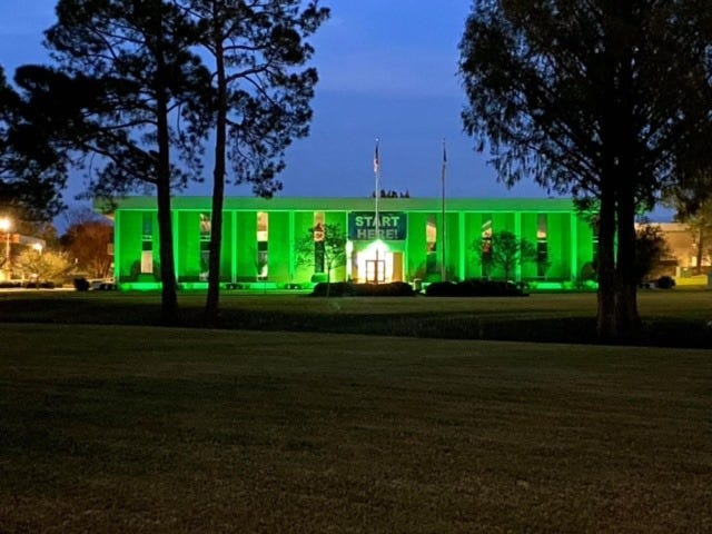 Lenoir Community College is serving U.S. Veterans by participating in the Greenlight A Vet campaign.  LCC is challenging its students, staff, and the community to join us as we light the city in green in honor of the men and women who serve our country. The campus administration building will be lit in green for the month of November to bring awareness to the many veterans in our country that struggle transitioning back into the civilian world each year. LCC will be providing free lightbulbs to the community and they can be picked up in the financial aid office. For more information on the Greenlight A Vet campaign, visit www.greenlightavet.com. [CONTRIBUTED PHOTO]