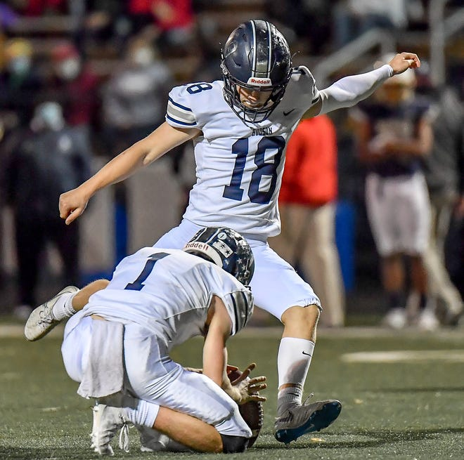 Hudson senior kicker Jake Vidmar swings into and extra point attempt during Hudson''s Division II regional final at Archbishop Hoban Nov. 6. Vidmar completed his career with an Ohio state record with 122 straight extra points.