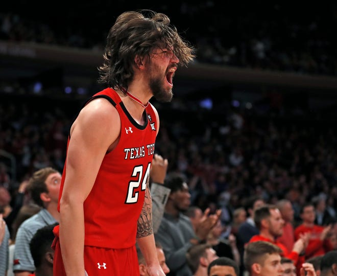 Texas Tech guard Avery Benson (24) cheers from the bench during the second half of a Jimmy V Classic game Dec. 10, 2019 at Madison Square Garden In New York.