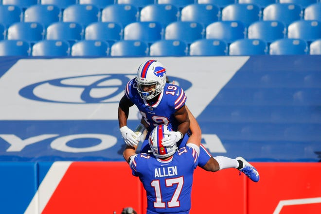 Buffalo Bills quarterback Josh Allen (17) celebrates with teammate Isaiah McKenzie after they connected for a touchdown during the first half of an NFL football game against the Seattle Seahawks Sunday in Orchard Park, N.Y.