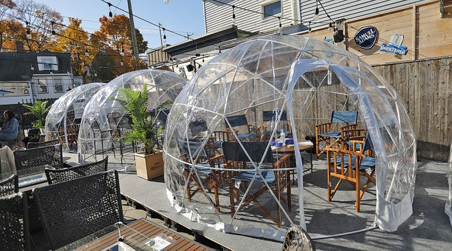 At the Pour Yard restaurant in Quincy, customers can enjoy outdoor dining inside a heated and lighted dome. Greg Derr/The Patriot Ledger