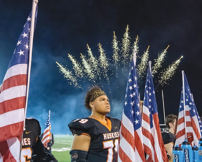 Pawhuska lineman Jamar Goff stands at attention during pregame activity Friday night.