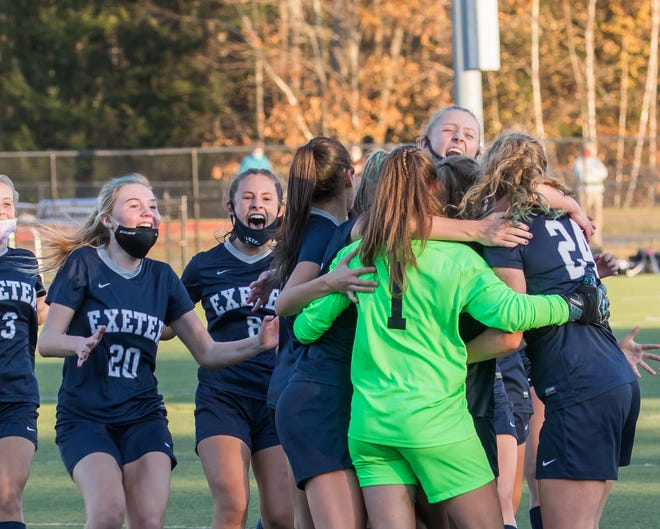Exeter High School girls soccer players rush the field after defeating Windham in Sunday's Division I state championship game at Eustis Field. The Blue Hawks won 5-0.