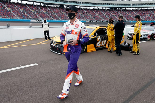 Denny Hamlin walks down pit road prior to Sunday's NASCAR Cup Series race at Phoenix Raceway in Avondale, Ariz.