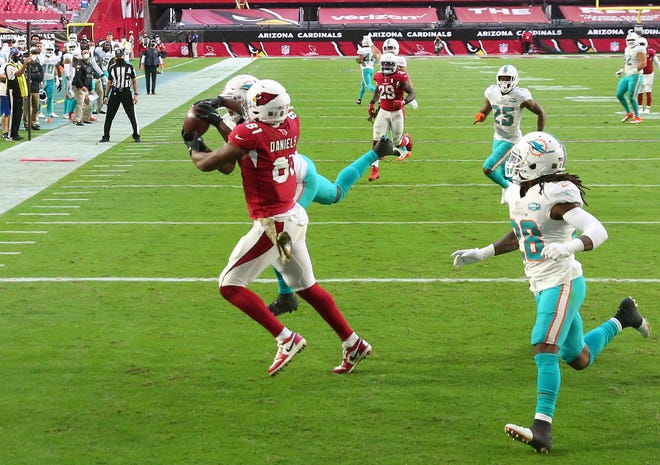 Cardinals tight end Darrell Daniels catches a touchdown pass while being defended by Dolphins cornerback Byron Jones during the third quarter of Sunday's game.