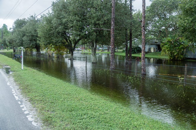 Some yard flooding at the corner of 157th Ct. N and 133rd Terrace N in Jupiter Farms after Tropical Storm Eta passed near South Florida, Monday, November 9, 2020. (JOSEPH FORZANO / THE PALM BEACH POST)
