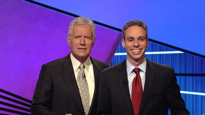 Scott Singer, right, is shown with Jeopardy! host Alex Trebek after a taping of the show. Singer, who is now mayor of Boca Raton, appeared on two episodes of the show in 2013.