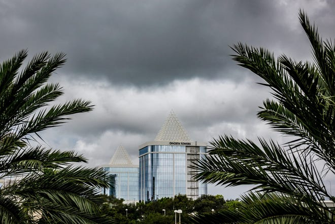 Dark clouds move in quickly as rain passes over the DiVosta Towers on PGA Boulevard in Palm Beach Gardens in this 2019 photo.