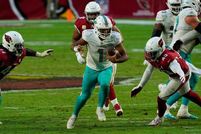 Miami Dolphins quarterback Tua Tagovailoa (1) runs against the Arizona Cardinals during the second half of an NFL football game, Sunday, Nov. 8, 2020, in Glendale, Ariz.