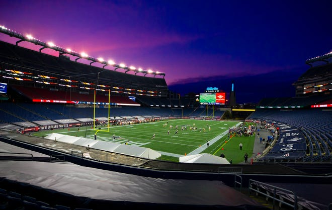As the sun sets, dusk settles over Gillette Stadium during an NFL football game between the New England Patriots and the San Francisco 49ers, Sunday, Oct. 25, 2020 in Foxborough, Mass.