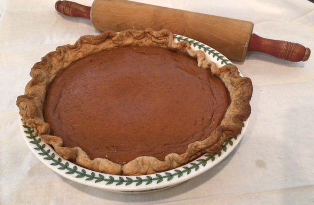 Maria Izzi Greene made her mother's pumpkin pie and photographed it with her worn-out rolling pin.