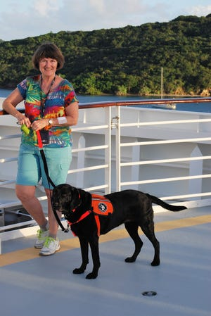 Christine Goodier and her service dog, Raylene, depart from St. Thomas on a cruise ship.