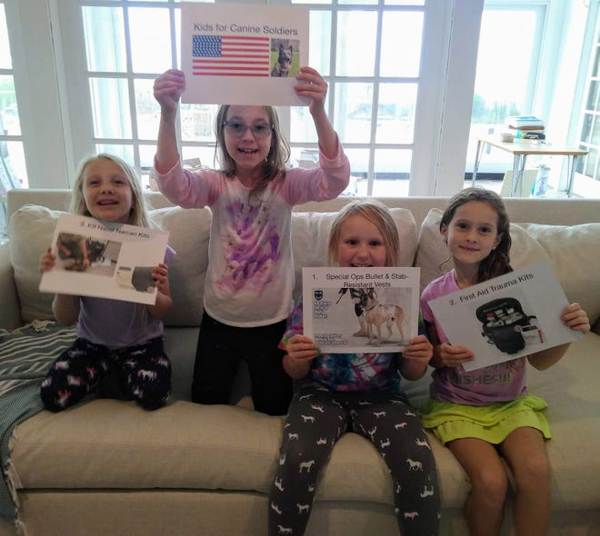 Nine year old Avlyn, (second from left), a resident of New Bern, has started a fundraising group called Kids for Canine Soldiers. Partnering with a non-profit in Florida, Project Paws Alive, the organization helps to raise money for military working dogs. She is pictured at her 9th birthday party from which she decided to donate all of her birthday money to the cause after creating a 'Mission Birthday Challenge'. She is hoping other kids will consider asking friends and family to donate to the military working dogs. For more information, visit https://projectpawsalive.org/kidsforcaninesoldiers/. [CONTRIBUTED PHOTO]