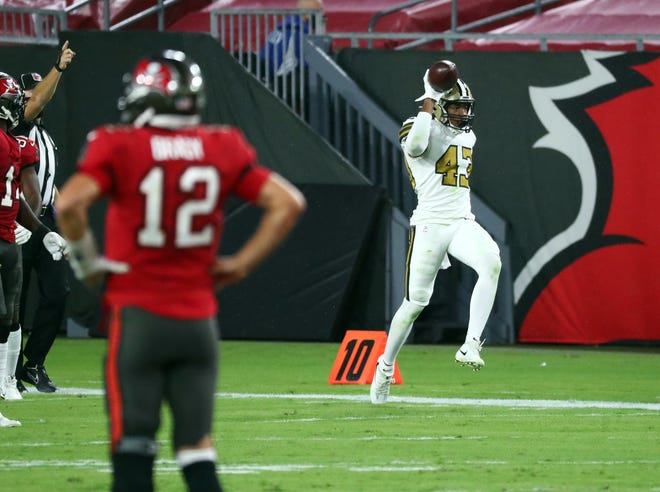 Saints free safety Marcus Williams (43) celebrates after hi intercepts Buccaneers quarterback Tom Brady (12) during the first half Sunday night in Tampa, Florida.