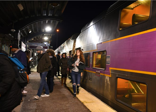 Evening commuters disembark an MBTA train at Union Station in Worcester in January 2019.