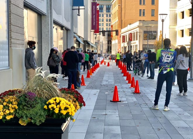 There was a long line for COVID-19 testing outside the Mercantile Center in Worcester at noon Monday, November 9, 2020.