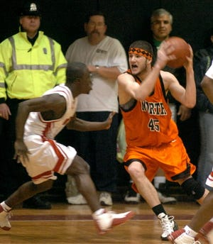 North's Kevin Mulready grabs a rebound from South's Prince Ofosu during a game in 2005