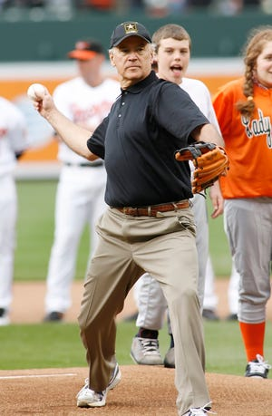 As vice president, Joe Biden throws out the first pitch prior to the Opening Day game in 2009 between the Yankees and Orioles at Camden Yards.
