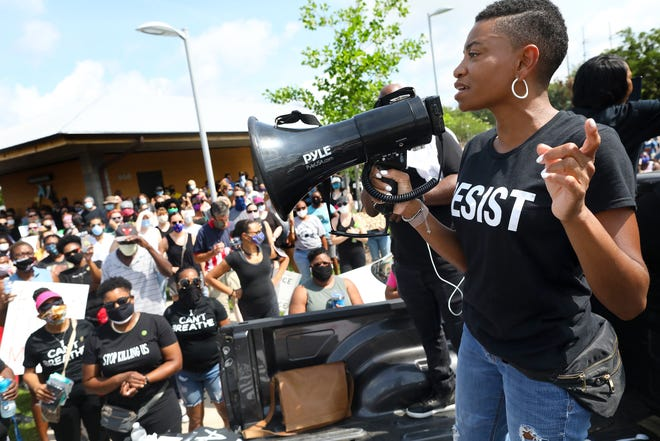 Aeriel Lane, organizer of the March for Peace in Gainesville, talks to the more than 1,000 people gathered May 30 at Depot Park to protest the killing of George Floyd by a police officer in Minneapolis.
