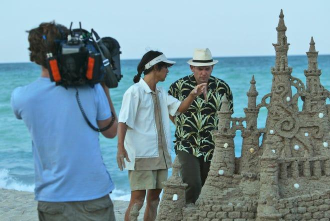 A television crew films a show in Miami Beach.