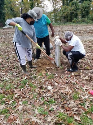 Chari Bostick and volunteers from the Community Action Group worked Sunday to replace veterans' headstones at historic Southern Hill Cemetery.