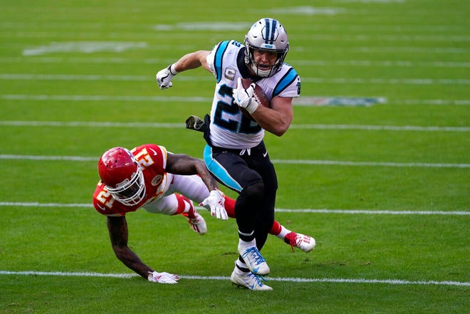 Carolina Panthers running back Christian McCaffrey (22) runs against Kansas City Chiefs cornerback Bashaud Breeland (21) during the second half of an NFL football game in Kansas City, Mo., Sunday, Nov. 8, 2020. (AP Photo/Jeff Roberson)