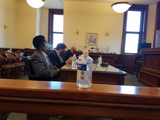 George W. Jones, Jr. (left) is sentenced Monday in Tuscarawas County Common Pleas Court.