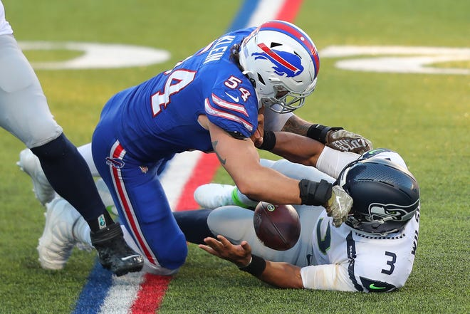 Buffalo Bills linebacker A.J. Klein sacks Russell Wilson of the Seattle Seahawks on Sunday at Bills Stadium in Orchard Park, N.Y. Wilson fumbled and Klein recovered.