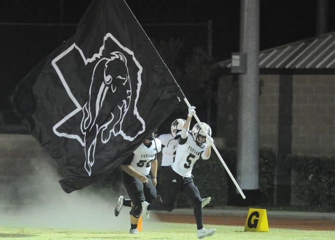 Forsan senior Ethan Harbour (5) carries a Buffaloes flag onto the field before a game against Hawley on Friday, Nov. 6, 2020, at Forrest Field in Hawley.