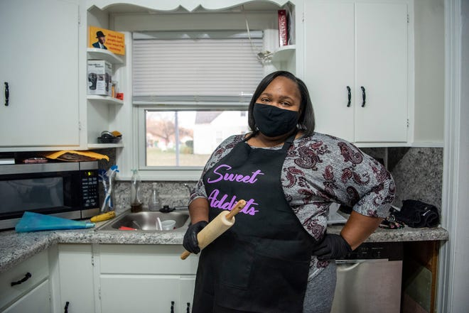 Entrepreneur Coweta Smith poses for a portrait inside her kitchen on Monday, Nov. 9, 2020 in Battle Creek, Mich. Smith has joined the Morning Light SecondMuse cohort to grow her business Sweet Addicts.