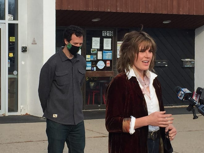 Vermont-born musician Grace Potter, with Higher Ground owner Alex Crothers, discusses efforts to save music venues at a news conference held outside Higher Ground in South Burlington on Nov. 9, 2020.