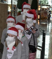 The Donahue family of Levittown, Pa., waits to be photographed with Santa Claus Friday at Cherry Hill Mall.