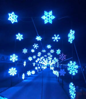 The snowflake tunnel is one of the fun features at Light Up the Fair, happening nightly at Boone County Fairgrounds from Nov. 13-Jan. 2.