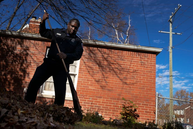 Tyrone Gentry racks leaves in his East English Village house's backyard on Nov. 9, 2020, in Detroit. Gentry wanted to get the leaves out of the way before it started to snow.