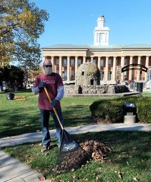 Joe Johnson, a Master Gardener volunteer, cleans up Veteran Park.