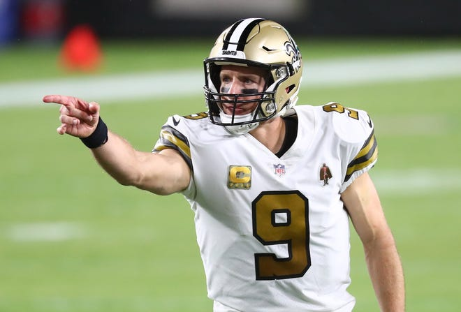 Nov 8, 2020; Tampa, Florida, USA; New Orleans Saints quarterback Drew Brees (9) calls a play against the Tampa Bay Buccaneers in the first quarter of a NFL game at Raymond James Stadium.