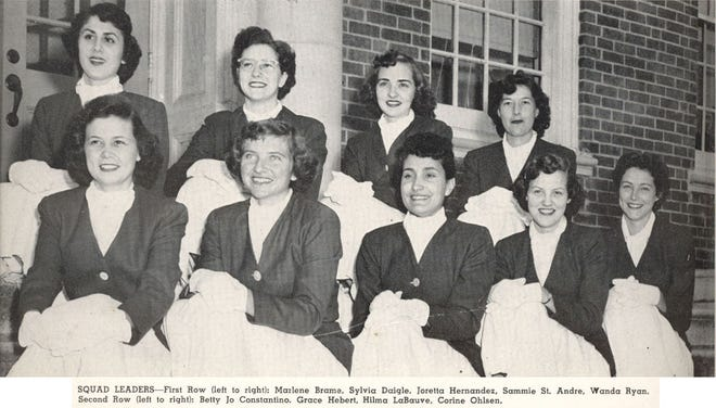 This photo from a 1953 edition of the yearbook at what is now the University of Louisiana at Lafayette shows leaders of the Red Jackets, a pep squad at the school from 1937-1957. In 1950, Hilma LaBauve, now Levis, (second row, third from left) wrote the fight song that the school still sings today.