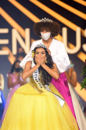 """Ki'ilani Arruda, Miss Hawaii, winner of Miss Teen USA 2020, is crowned with the """"Power of Hope"""" Crown, presented by Mouawad, the official crown sponsor of the 2020 Miss Teen USA competition, by Kaliegh Garris, Miss Teen USA 2019, at the Miss Teen USA Competition, on November 7, 2020 at Graceland in Memphis, Tennessee."""