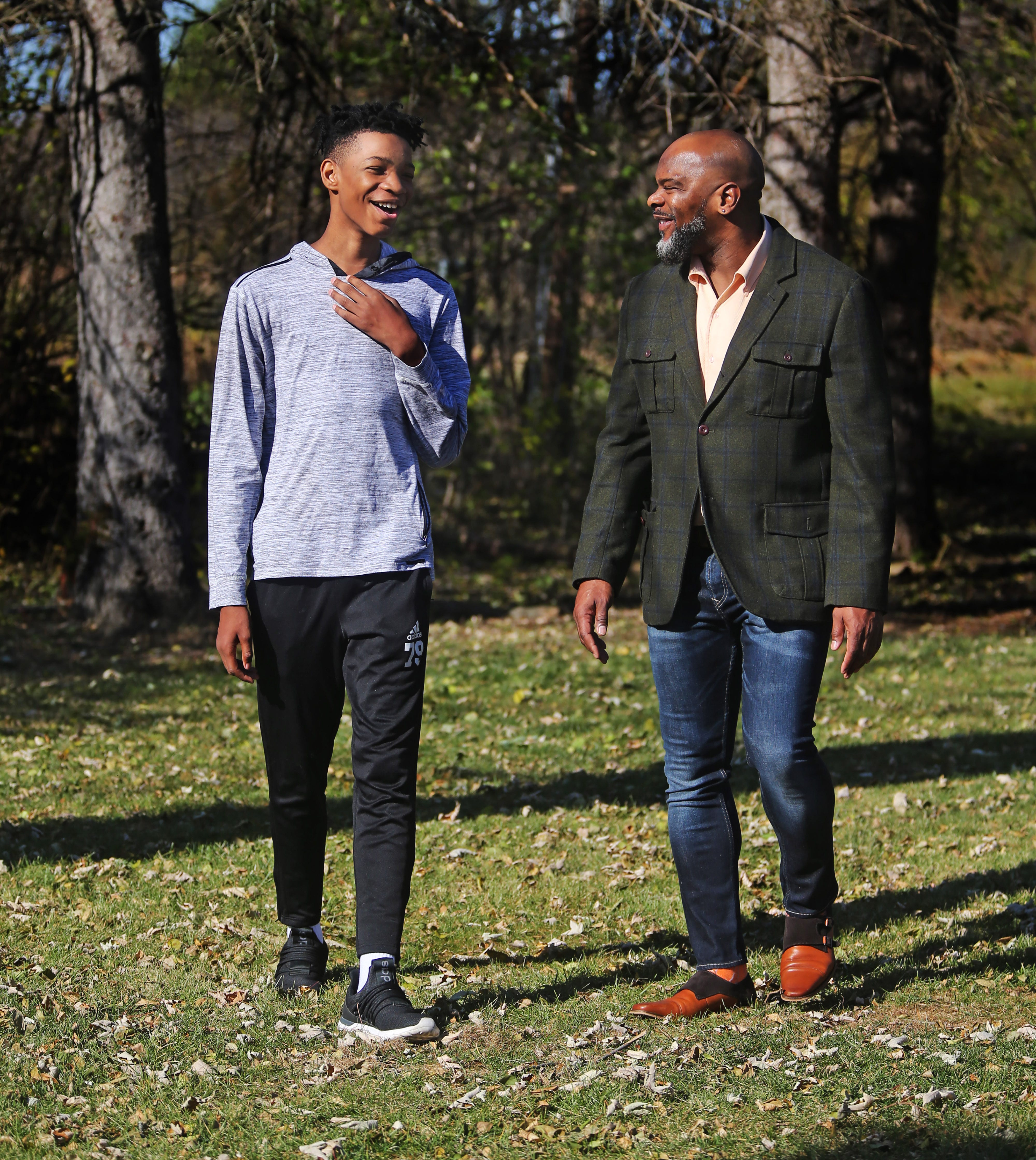 Dillan Burns, 14, left, spends time with his dad, Daryl Burns, 46, a former principal at Vincent High School in Milwaukee. Daryl Burns said that he got his son interested in reading by taking him to the library and letting him discover for himself what he wanted to read.