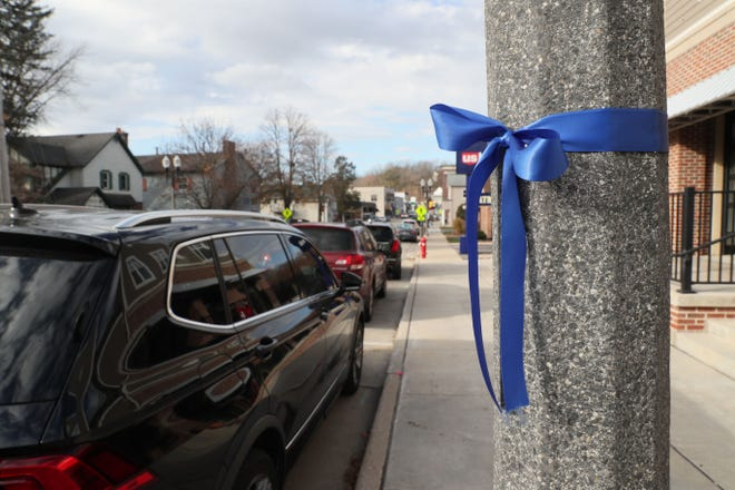 Blue ribbons around poles and trees along East Capitol Drive, and the business District in downtown Hartland show support for the two police officers who were shot while investigating a crash on Friday, Nov. 6, outside the Holiday Inn Express in Delafield.