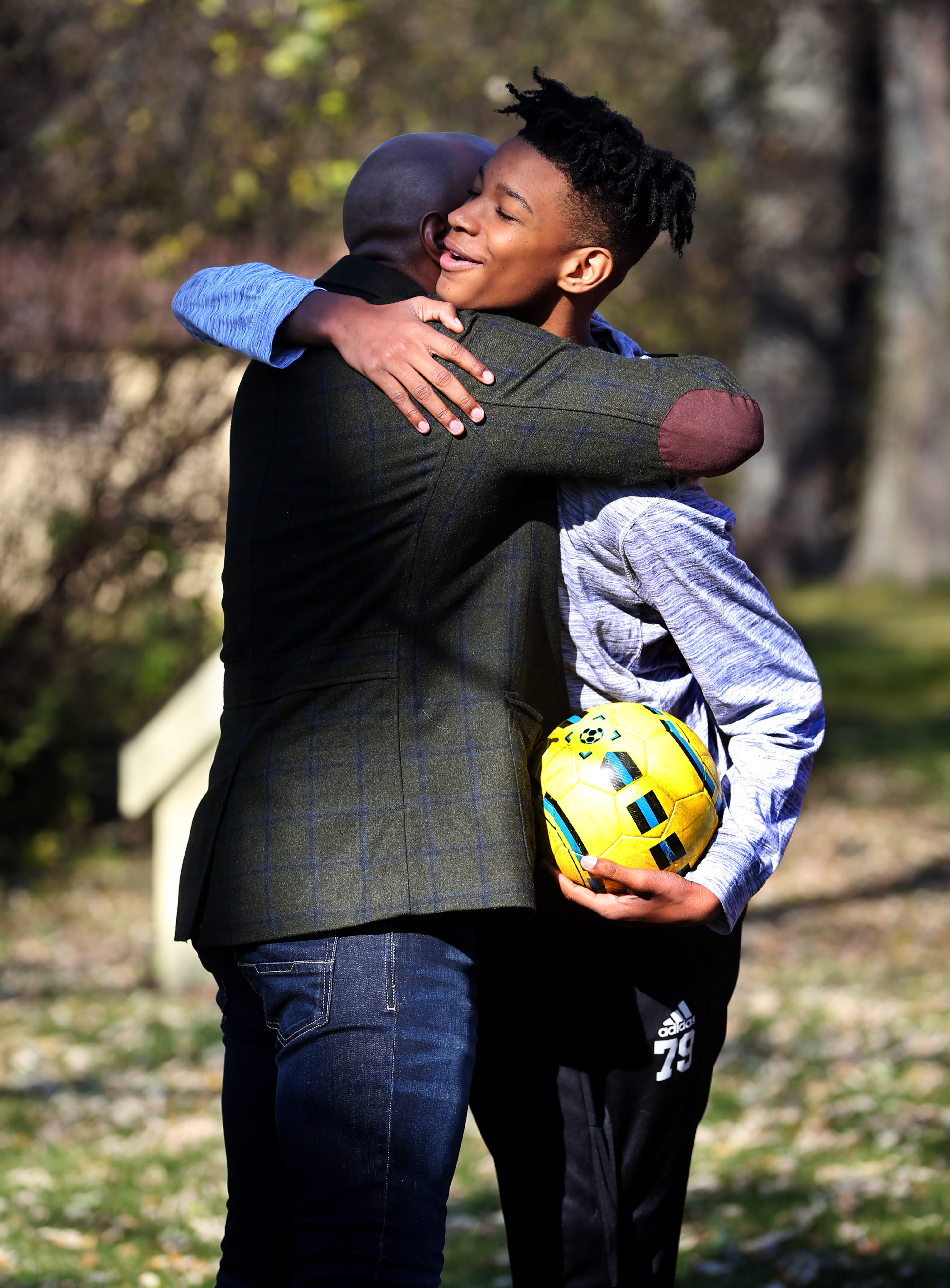 Dillan Burns, 14, hugs his dad Daryl Burns, 46. Daryl Burns, a former principal at Vincent High School, said when it comes to reading, the goal must be to turn kids into lifelong readers.