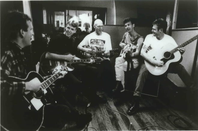 The band Midnight Oil in a 1993 publicity photo, from left: Jim Moginie, Martin Rotsey, Peter Garrett, Rob Hirst, 'Bones' Hillman. Bassist and vocalist Hillman died Saturday in Milwaukee following a battle with cancer. He was 62.