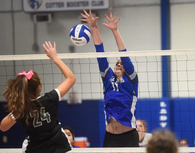 Cotter's Kate Cheek blocks against Izard County during a match earlier this season. Cheek was one of four Lady Warriors named all-state or all-state tournament this season during their 19-2 campaign.