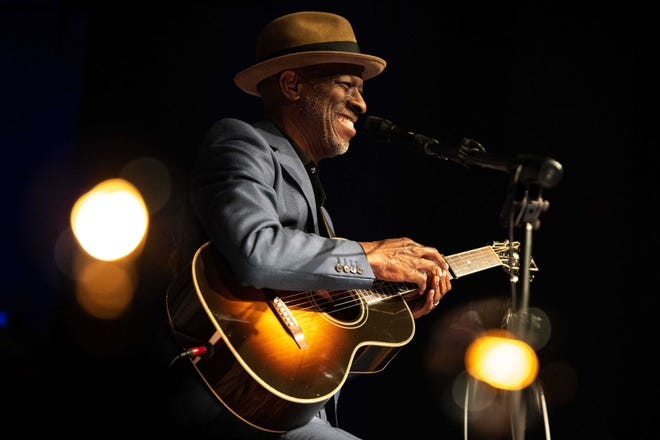 Keb' Mo' smiles as he performs for the audience at the Franklin Theatre in Franklin, Tenn., June 7, 2019.