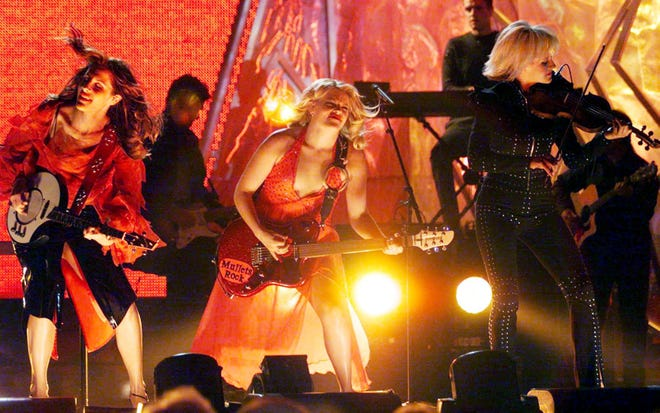 "The Dixie Chicks perform ""Sin Wagon"" before winning the Album of the Year award for Fly during the 34th annual CMA Awards show at the Grand Ole Opry House Oct. 4, 2000."