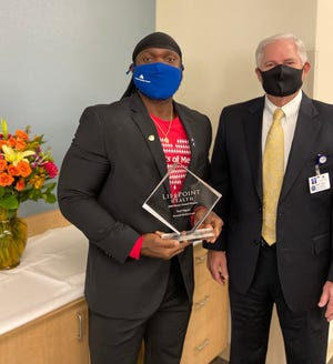 LifePoint Health named Karl Ngoye, left, from Memorial Medical Center in Las Cruces, New Mexico, the recipient of its 2020 national Mercy Award.