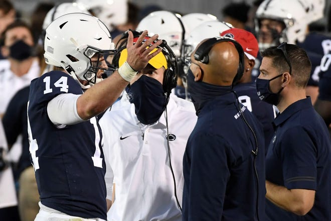 Penn State quarterback Sean Clifford (14) talks with head coach James Franklin during an NCAA college football game against Maryland in State College, Pa., on Saturday, Nov. 07, 2020. (AP Photo/Barry Reeger)
